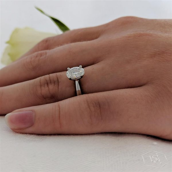 oval cut platinum solitaire plain band